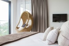 08 A rattan chair hanging in the bedroom is a cool and fresh idea