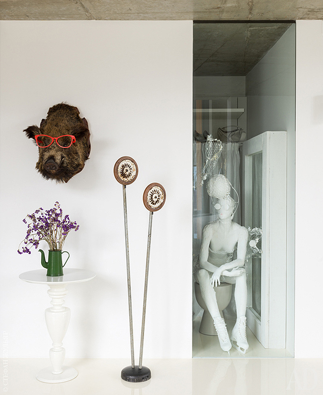 Sculptures and faux taxidermy can be seen throughout the space