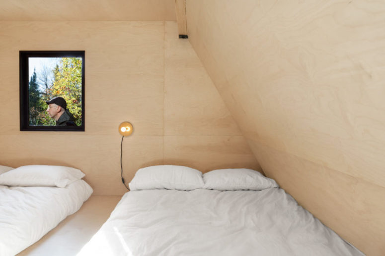 The kids' room features much plywood, a platform with two beds and storage space inside