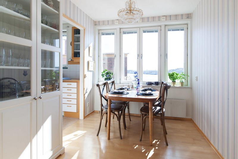 There's a separate dining room with a view and a vintage cupboard