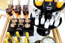 08 a brass bar cart with glitter bottles, fringe cupcake toppers and a glitter clock