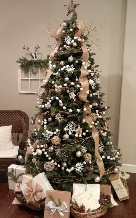 a chic Christmas tree decorated with silver snowflakes, pompoms, pinecones and burlap ribbons