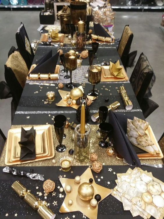 a fun black and gold tablescape with stars, stripes and candles is amazing for a New Year's Eve