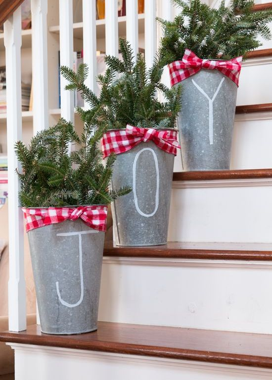buckets with evergreen branches and plaid ribbons for a cool rustic feel