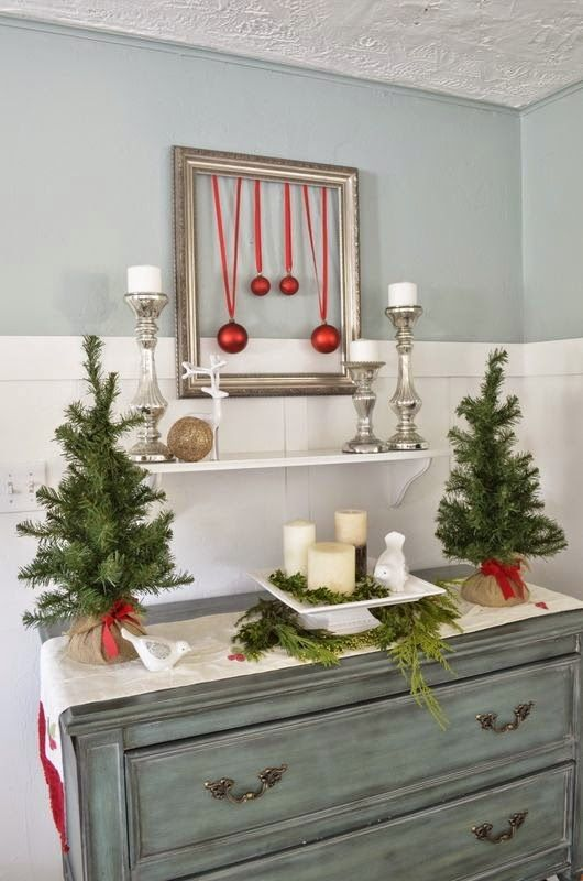 evergreen trees, a display with evergreens and candles and a framed ornament artwork