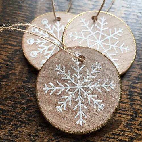 wood slice gilded edge snowflake ornaments look rustic and glam at the same time