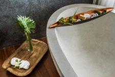 09 A natural stone bathtub is sure to leave a spa feel and natural wood adds to the space, too