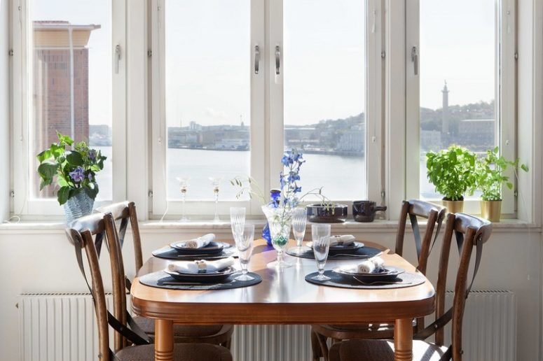 Here you'll see a vintage wooden dining set and cool views - in case it's cold outside, it's cool to dine here