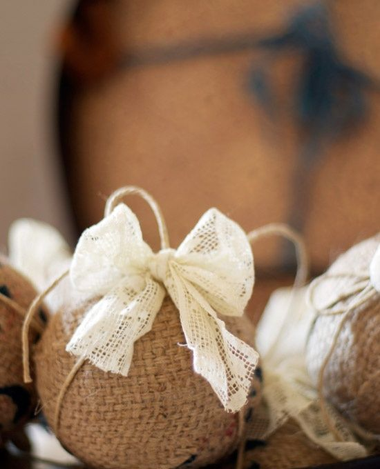 a burlap ornament with a lace bow is a cute vintage-inspired and rustic decoration