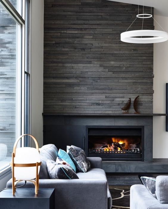 a reclaimed wood panel wall to highlight the fireplace
