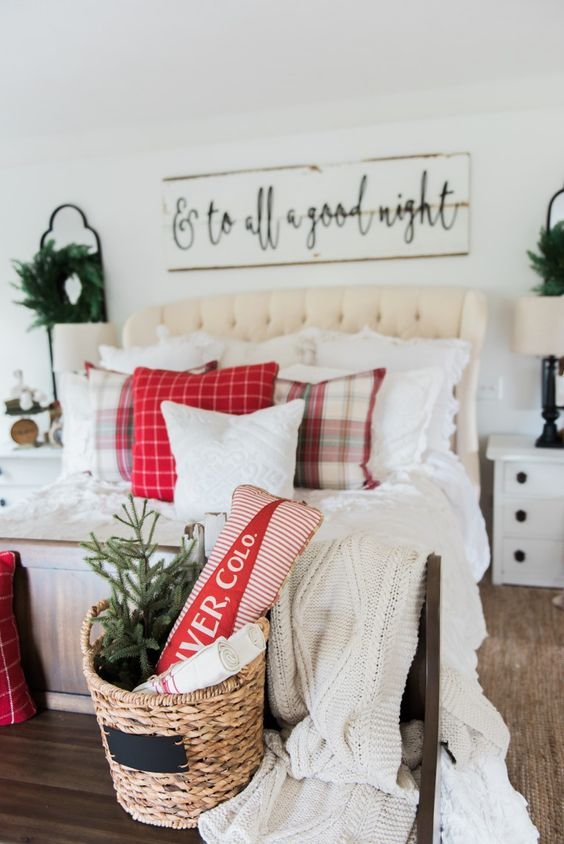 a wicker basket some red and plaid touches and neutral bedding for a cozy farmhouse