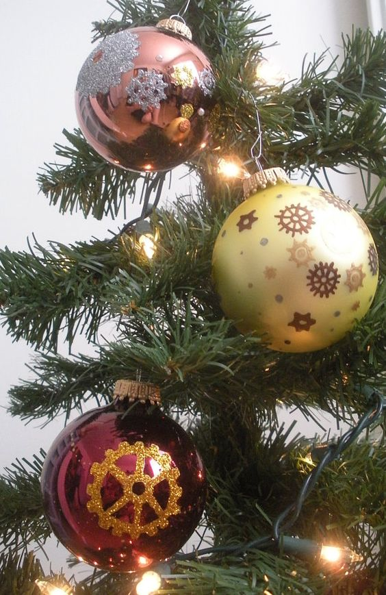 make some steampunk ornaments painting gears on baubles with glitter or contrasting paint