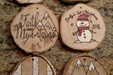 09 wood burnt and painted wood slice ornaments with snowmen, a moose, a bear and mountains