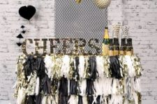 10 a cheerful black and silver sparkly fringe bar cart with a sign and lights and balloons around