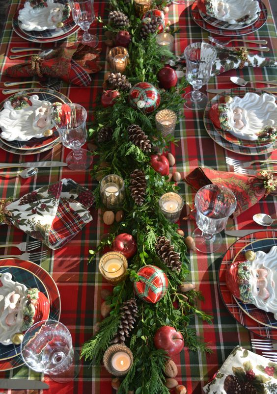 a plaid tablecloth, plaid napkins and plates and even plaid ornaments refreshed with evergreens