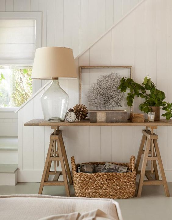a simple wooden trestle console plus a woven basket for a farmhouse interior