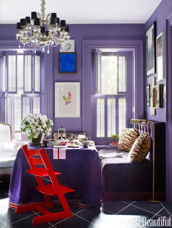 an ultra violet breakfast space with violet walls, furniture and a table