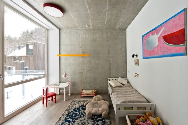 The kids' space is colorful and cute yet with concrete walls and wooden floors like everywhere else