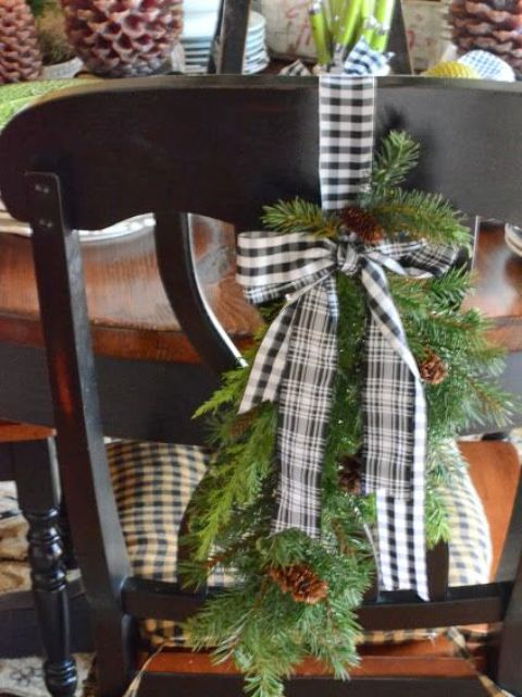 a buffalo check hanging with evergreens and pinecones for cool chair decor