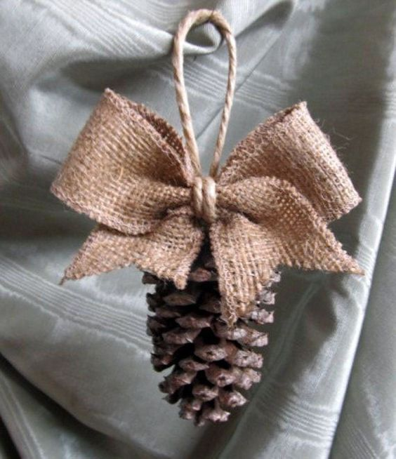 a burlap and pinecone ornament with twine for Christmas