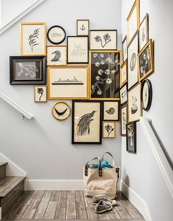 a chic gallery wall with gold and black frames to make the corner more eye-catching