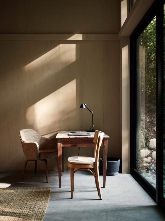 A small working space is located next to a window to enjoy the views while working