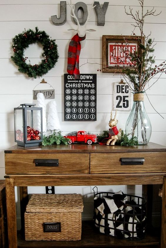 a lantern with red ornaments, vintage Christmas toys and a lit up wreath on the wall