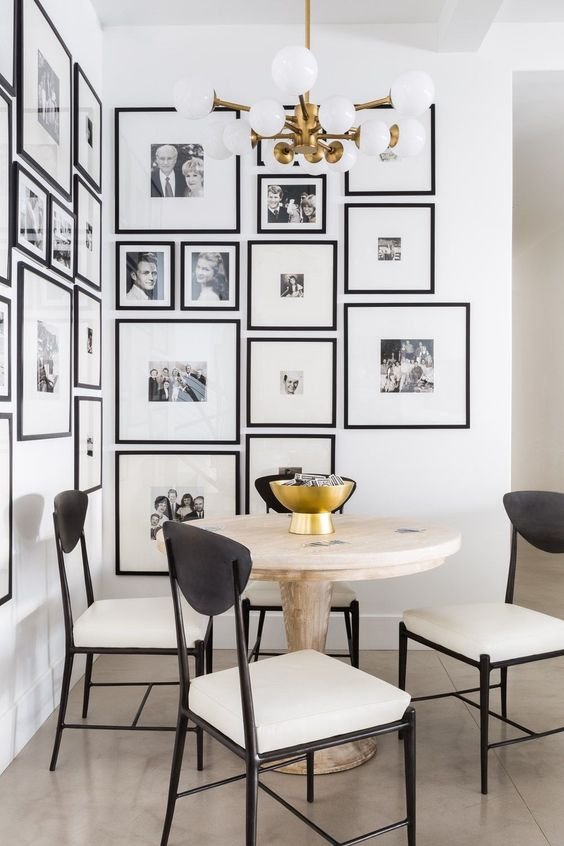 make your dining space more interesting creating a black and white gallery wall with your family pics