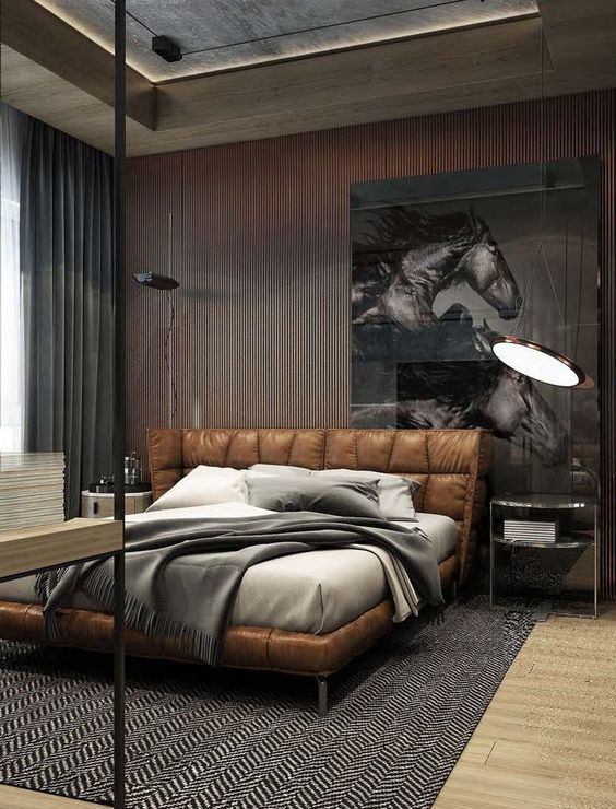 a gorgeous leather upholstered and padded bed for a chic and refined masculine bedroom