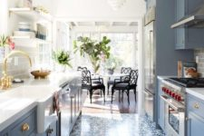 13 a pretty patterned tile floor that matches the cabinets in its colors