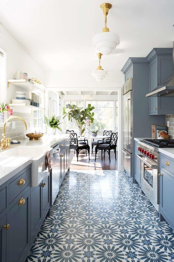 a pretty patterned tile floor that matches the cabinets in its colors