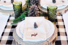 13 large pinecones, green glasses, greenery and mercury glass candle holders, wood slices as chargers
