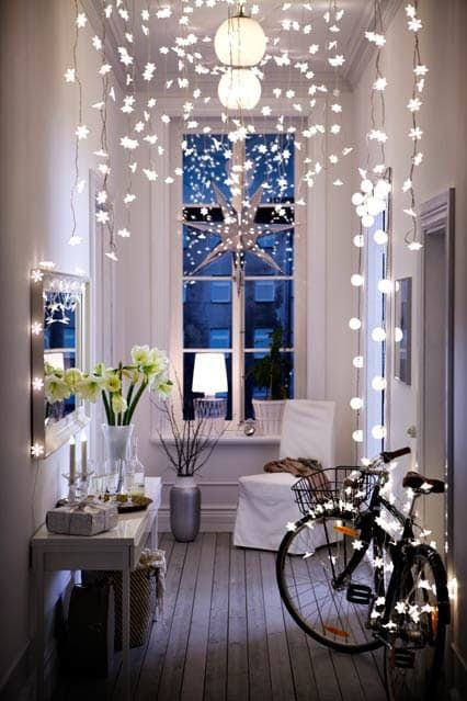 lots of string lights over the small entryway, several lamps and a shining star make it super welcoming