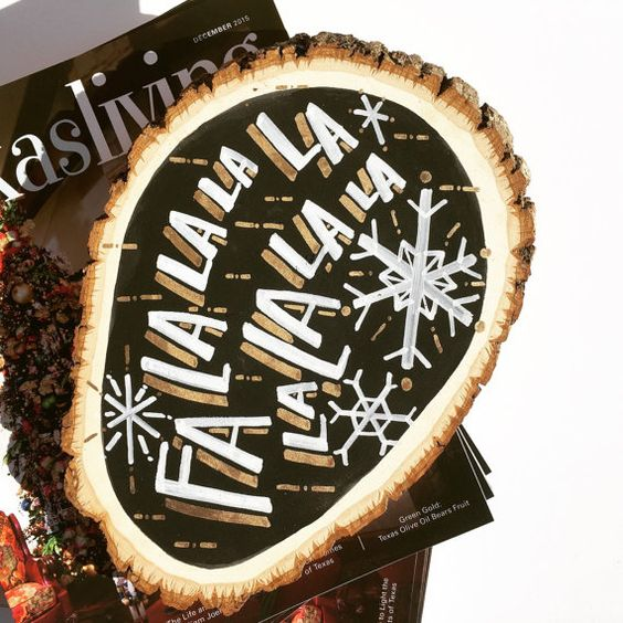 a black, white and gold Christmas sign with snowflakes and chic gilded touches