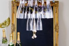 14 a glass and stirrers chandelier over the bar cart will make the drink station cooler