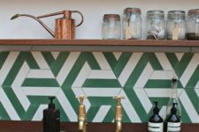 14 a green and white geometric tile backsplash looks very retro-inspired