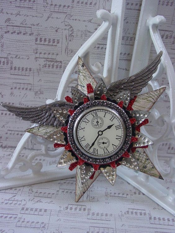 a steampunk decoration with wings, stars, a clock and some glitter touches