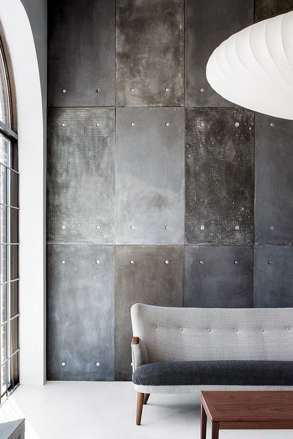 add a touch of industrial style with metal and concrete wall panels