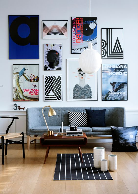 make the sofa wall more interesting with a bold gallery wall with various posters