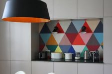 16 a bold geometric tile backsplash stands out in a neutral space