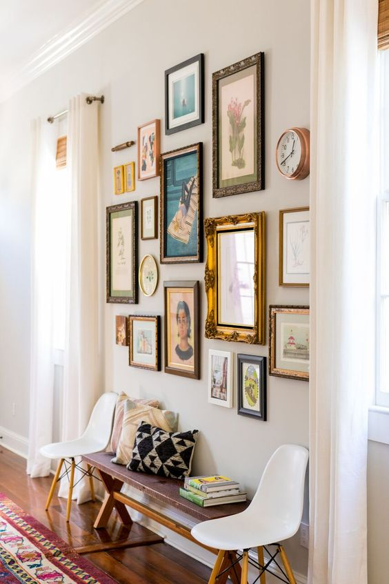 a vintage-inspired gallery wall with mismatching frames of various sizes and looks