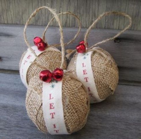 burlap ornaments with ribbon and red jingle bells are great for rustic tree decor