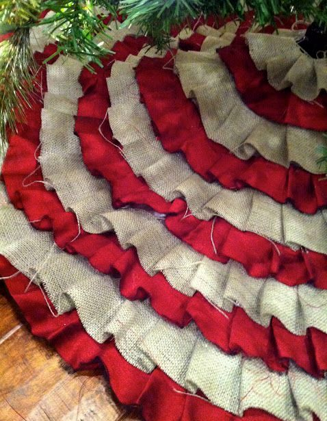 a red satin and burlap pleated Christmas tree skirt looks fun and cute