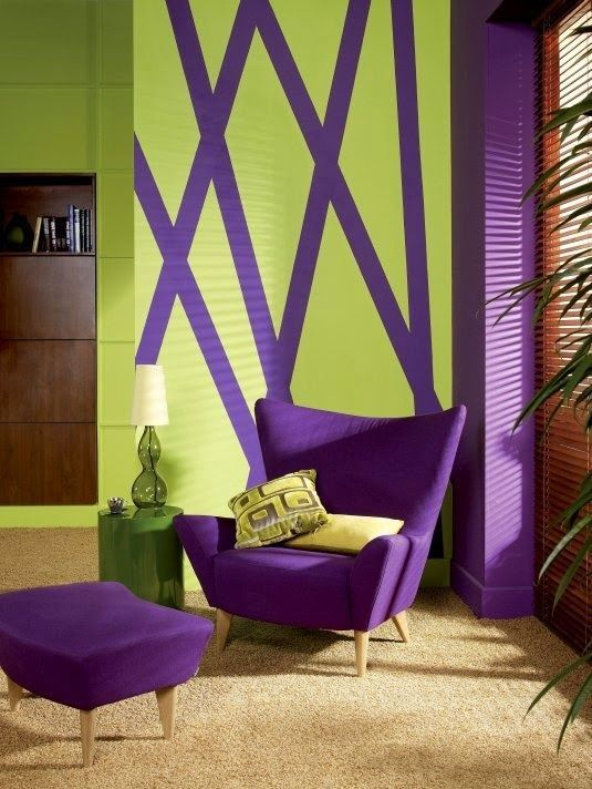 a violet upholstered chair and footrest, a matching pillar and a geometric artwork