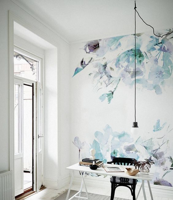 an airy girl's workspace and an accent wall done with watercolor floral wallpaper
