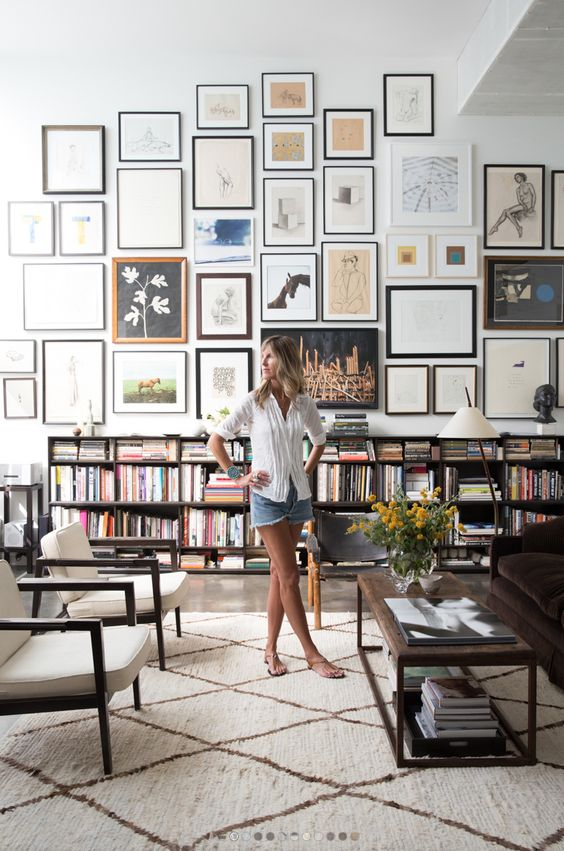 if you have high ceilings, a large gallery wall will make your blank space cooler
