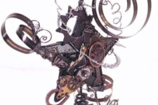 19 a crazy steampunk star tree topper with various gears and other details looks unusual