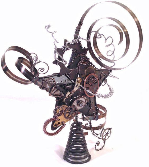 a crazy steampunk star tree topper with various gears and other details looks unusual