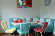 19 a dining zone in turquoise, red and yellow in the corner of the kitchen