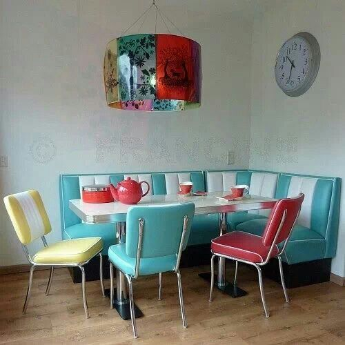 A Dining Zone In Turquoise, Red And Yellow In The Corner Of The Kitchen